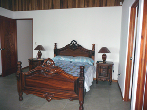 The master bedroom has a handsome matrimonial bed.